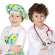 Little doctor and cook — Stock Photo