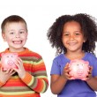 Four happy children with moneybox savings — Stock Photo