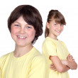 Adorable preteen girl and little boy in yellow — Stock Photo #9628538
