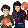 Little boy and pretty girl with moneybox — Stock Photo