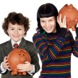 Little boy and pretty girl with moneybox — Stock Photo #9628558