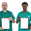 Medical team with clipboard and blank paper — Stock Photo #9628620