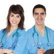 Couple of young doctors — Stock Photo #9628690
