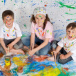 Children playing with painting — 图库照片