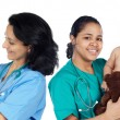 Two pediatricians with beautiful babies — Stock Photo