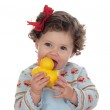 Beautiful blue-eyed baby sucking a rubber duck isolated — Stock Photo #9628878