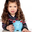Adorable baby with a blue money-box — Stock Photo #9628934