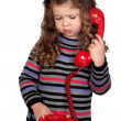 Adorable baby with a red telephone - Stock Photo