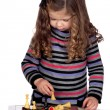 Adorable baby girl playing chess - Stock fotografie