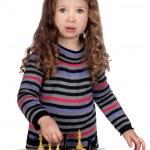 Adorable baby girl playing chess — Stock Photo