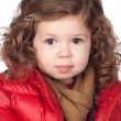 Beautiful baby girl with red coat — Stock Photo #9628965