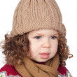 Beautiful baby girl with wool cap — Stock Photo #9628972