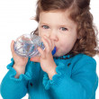 Beautiful baby girl with drinking with a water bottle - Stock Photo