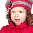 Smiling baby girl with wool cap - Stock Photo
