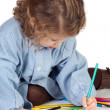 Beautiful girl with preschool uniform painting — Stock Photo #9629041