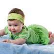 Baby girl smiling lying face down — Stock Photo #9629088