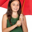 Pretty teen girl with a red umbrella — Stock Photo #9629414