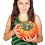 Happy girl in Halloween with a big pumpkin — Stock Photo #9629435
