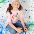 Girl playing with painting - Stock Photo