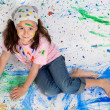 Girl playing with painting — Stockfoto