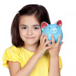 Brunette little girl with a blue moneybox — Stock Photo #9629934