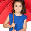 Brunette little girl with a red umbrella — Stock Photo