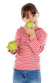 Girl eating an apple — Stockfoto