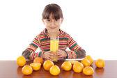 Girl with oranges — Stock Photo