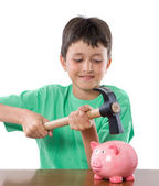 Boy with moneybox and hammer — Stock Photo