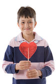 Funny child with lollipop with heart-shaped — Stock Photo
