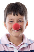 Portrait of a pretty child with a clown nose — Stock Photo