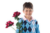 Boy offering flowers — Stock Photo