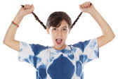 Girl holding braids and shouting — Stock Photo