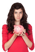 Teenager girl with pink piggy-bank — Stock Photo