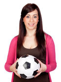 Beautiful brunette girl with soccer ball — Stock Photo