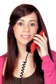 Brunette girl with a phone — Stock Photo