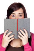 Brunette girl with a reader — Stock Photo