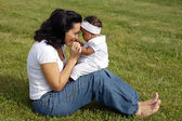 Mother playing with her daughter — Stock Photo