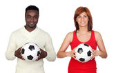 Beautiful redhead girl and attractive african men with a soccer — Stok fotoğraf