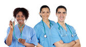 Medical team of three doctors — Stock Photo