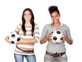 Two pretty girls with a soccer ball — Stock Photo
