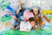 Friends playing with painting — Stock Photo