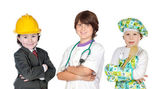 Three children with clothes of differents profession — Stock Photo