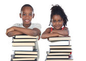 Brothers supported on a stack of books — Stock Photo