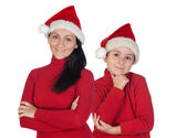 Mother and son with Christmas cap — Stock Photo