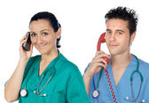Medical team to the phone — Stock Photo