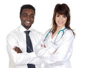 Attractive african businessman and pretty doctor girl — Stock Photo