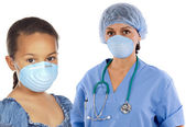 Pretty girl and doctor women with protective mask on her face — Stock Photo