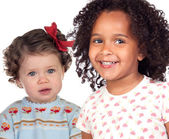 Two beautiful baby girls of different races — Stock Photo