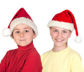 Funny child and smiling preteen with Santa Claus hat — Stock Photo